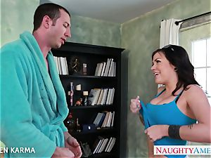 Tattoed dark-haired Karmen Karma licks a huge weenie
