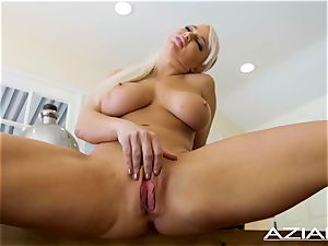 handsome ash-blonde bombshell London sea plays with her shaved cooter