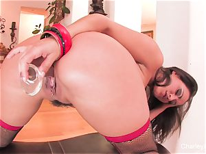 Naturally big-boobed Charley romps herself with a glass toy