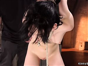 brown-haired caned and played in hogtie
