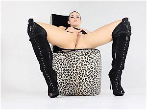 blonde Dahlia keeps her boots on as she milks