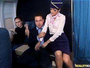 Air hostess Lexy Rose takes a bone scrotum deep on the flat