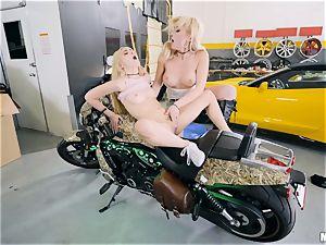 Cristi Ann and Jane Wilde scissor in the garage