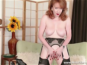 big-titted red finger fucks vagina in garter nylons and pumps