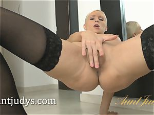 blonde cougar Vanessa Hell taunts you in her stocking