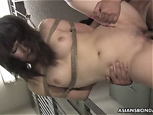 chinese beauty gets pounded with intensity behind the beams